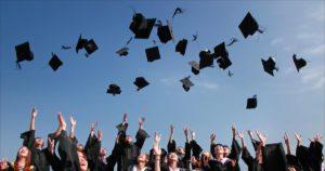 seniors graduation caps in the air